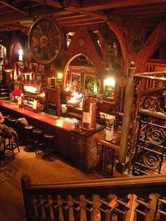 """pub """" The Quays"""" - The Quays Pub, Galway, Ireland. The interior has stained windows, Gothic arches and church pews. Some of the interior was imported from a French medieval church. Photo by G Fulvia. Republic of Eire"""