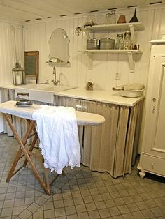 Sweet laundry room!~...LOOKS LIKE THE BOARD MY MOM TAUGHT ME TO IRON ON  !!..(I still have it)..<3<3<3
