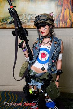 Tank Girl- Mod shirt, vest with pins, smudged makeup under eyes, goggles on helmet