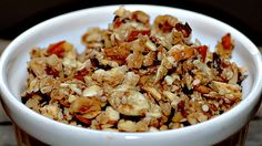 This Paleo breakfast cereal recipe for a healthy gluten free Granola is made with almonds, macadamia nuts, pumpkin seeds and raisins.