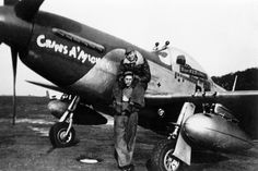Ground crew in front of P-51 Mustang (PE-P, serial number 44-14906), named…