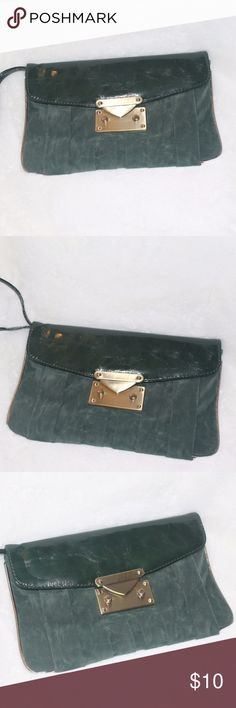 Great Holiday Clutch This is such a great little bag - barely used and ready for action! It is immaculate on the inside, the outside, because part of it is suede (it is suede and patent leather), shows every little line, but no rips, tears, etc. - Beautiful art deco, 1940's style purse. It has a gold piping and gold buckle accents.  Measures approximately 10 x 6.5 inches.  Zipper pocket and 2 pouch pockets on the inside - perfect for the day or night out on the town :)  Happy to answer any…