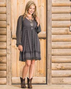 "Ariat Women's ""Belltown"" Charcoal Black Lace Long Sleeve Dress - Ariat's Belltown women's lacy dress combines comfort and beauty. A cute and flirty dress to wear with western boots, the Belltown comes in a lovely shade of charcoal black and has long flowing lace sleeves. Other features include an asymmetrical hemline and elastic encased waist. This dress is made of comfortable rayon crepe with lace at the sleeves and hem 