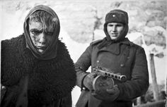 In February of 1943, a Soviet soldier stands guard behind a captured German soldier. Months after being encircled by the Soviets in Stalingrad, the remnants of the German Sixth Army surrendered, after fierce fighting and starvation had already claimed the lives of some 200,000