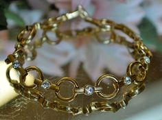 VINTAGE Signed AVON Golden Rings Diamante Rhinestone Tennis Bracelet Jewelry  #Avon #Tennis