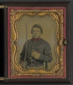 [Unidentified young soldier in Confederate uniform with saber] | Library of Congress