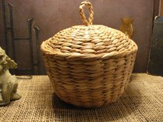 Vintage handmade braided STRAW BASKET Organic wood basket with lid. €7.00, via Etsy.
