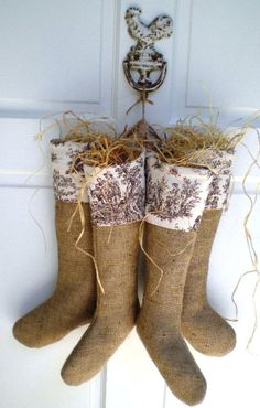 "This romantic Country French Burlap Stocking has a cuff designed with French Shabby ""Rustic Toile"" in Chestnut and Ivory fabric*. The stocking is lined with unbleached muslin, hangs by a 2"" jute trim loop, and is topped with removable raffia.   p stockings."