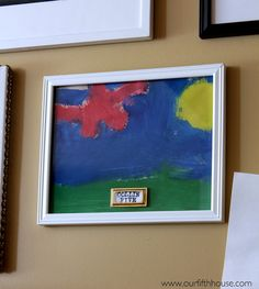 displaying children's artwork - use brass plate labels to add name & age