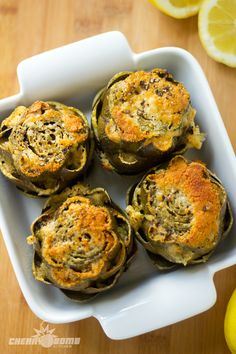 Baked Artichokes, can't wait to try this: Ingredients: Artichokes - 4 Whole Parmesan Cheese - 1/2 Cup Garlic - 4 Cloves Chopped Olive Oil - 4 tbsp Lemons - 3 Salt - To Taste Pepper - Fresh Cracked, To Taste Water - 1/4 Cup