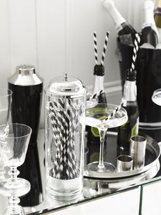 Add a classic cocktail bar at your wedding reception for an elegant focal point.