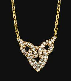 A diamond-set necklace, by Van Cleef & Arpels   The fetter-link chain set to the front with interlocking openwork links pavé-set with brilliant-cut diamonds, French marks, 39.0cm long  Signed VCA, no. B4151 A14
