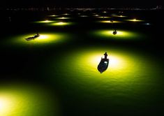 The lights from the boats attract the Shirasu eel at night in Tokushima, Japan. National Geographic'2017