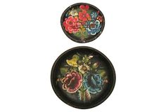 Pair of 1940s round hand-carved and hand-painted bowls made in Santa Fe, New Mexico. They incorporate a vibrant palette of red, pink, yellow, blue, green, white, and orange on a canvas of aged black. OneKingsLane.com