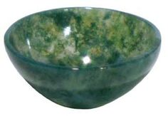 This large devotional bowl has been carved from moss agate crystal to make a beautiful addition to your altar and ritual magick. The natural stone creates intricate patterns and veins within the surface of the bowl, leaving no two bowls alike.A vessel for your ritual offerings