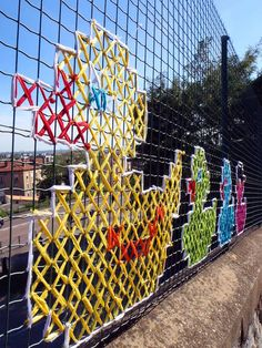 19 Artists Creatively Pushing the Boundaries of Embroidery - Street Art - Yarn Bombing, Pixel Art, Fence Weaving, Guerilla Knitting, Garden Crafts For Kids, Street Art, Fence Art, Diy Fence, Fence Ideas