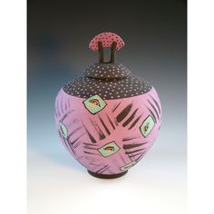 Wheel-thrown jar with lid in purple with aqua, chartreuse and orange accents. Layered matte glazes.  by Barbara Mann