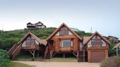 Brenton on Sea Chalets - Double story log cabin (the middle section) can sleep 2 adults and 2 children. It has a spa bath and small litchen area, plus two balconies with fantastic sea views. Knysna, Garden Route, South Africa. www.brentononseachalets.co.za