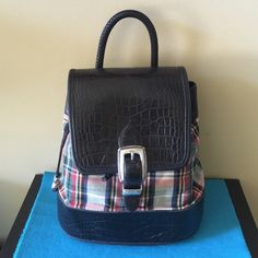 Brighton Backpack This is such a cute bag.  Black leather trim and silver hardware accent the plaid pattern.  Super clean inside and out.  Very gently used with only one small scratch as shown in picture.   Very comfortable straps! Brighton Bags Backpacks
