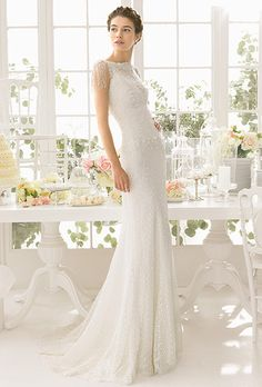 Brides: Aire Barcelona. Beaded lace dress in a natural color.