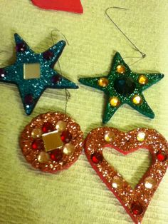 Hand made Yule ornaments #Yule Made with cornstarch dough, rolled, cut, dried, embellished and glitterized!
