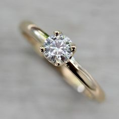 .50ct Crown Solitaire Ring - Eco-friendly and Ethical Engagement Ring by Aide-mémoire Jewelry   A 5mm Moissanite or ethical conflict-free diamond is prong set in gold or palladium. The setting is a crown style setting and the band is a narrow low-dome band.