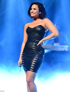 Leather lady: During her appearance on the Alan Carr show, Demi looked sensational in a sexy black mini dress which showed off every inch of her enviable-figure to perfection