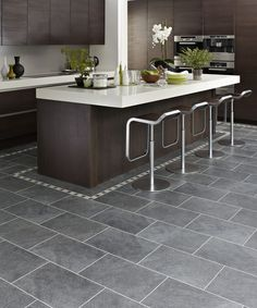 living room kitchen open concept with light wood floor dark