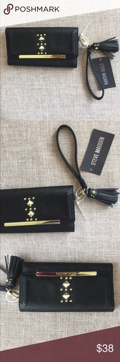 Steve Madden logo at trifold studded wallet black Adorable black trifold wallet with gold studs. Removable clutch strap and Embellished tassel. Check out those studs on the tassel 😍. Bundle to save! Steve Madden Bags Clutches & Wristlets