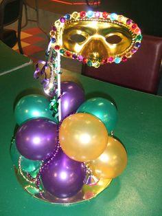 Mardi Gras centerpiece from:  www.partyfiestadecor.com