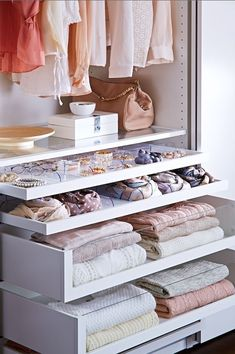Pull out drawers with glass fronts in closet.