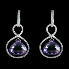 Amethyst Earrings. Accompanied by 41.70 carats of Amethyst and 2.06 carats of Diamonds.