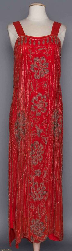 SILVER BEADED CORAL DRESS, c. 1920. Silk chiffon, silver beads form floral & star patterns, dress & wide shoulder straps have added silk under dress