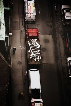 Tied Down Typeface: Giant letters of a sign for New York Magazine are captured en route by photographer Kirk Bannon out of his hotel window at the Palace Hotel.