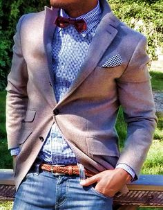 Blazer with red bow tie, gingham shirt, brown braided belt, and jeans.