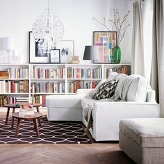 A comfortable sofa bed means this room is a library by day and a guest room by night.