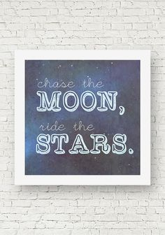 "A square quote print that reads, ""Chase the moon, Ride the Stars."" Blue wall art typography."