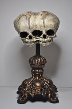 "The extremely rare condition of conjoined, or Siamese twins joined at the head is called Cephalopagus. They are also called janiceps, after Janus, the 2-faced god. This macabre specimen is well suited for scientific display in a curiosity cabinet or part of a gothic decor. It measures 7"" tall with the base, and 4"" front to back.    Skull is cast in resin and hand painted"