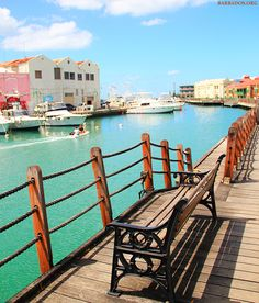Have a seat on a bench along the waterfront. This scenic boardwalk can be found in Bridgetown, Barbados.