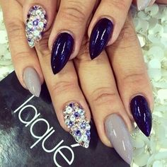 Dark blue and grey with colored gems acrylic nails