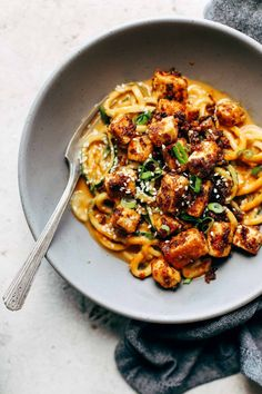 Spicy Sesame Zoodles with Crispy Tofu! SUPER easy recipe with familiar ingredients - soy sauce, peanut butter, sesame oil, garlic, zucchini, and tofu. Vegan / Vegetarian #pasta #vegetarian #vegan #healthy #dinner #recipe | pinchofyum.com