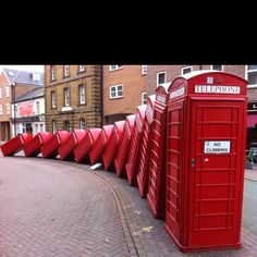 Sculpture of old-style red telephone boxes in England. Picture taken in Kingston-upon-Thames.