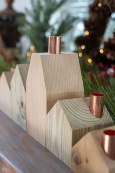DIY Wood House Candle Holders <br> These DIY Wood House Candle holders are rustic and beautiful. They're so easy to make, you'll want to create your own little wood house village! House Candle Holder, Concrete Candle Holders, Candle Holder Decor, Wooden Candle Holders, Diy Christmas Village, Christmas Wood Crafts, Modern Christmas, Christmas Diy, Scandinavian Christmas