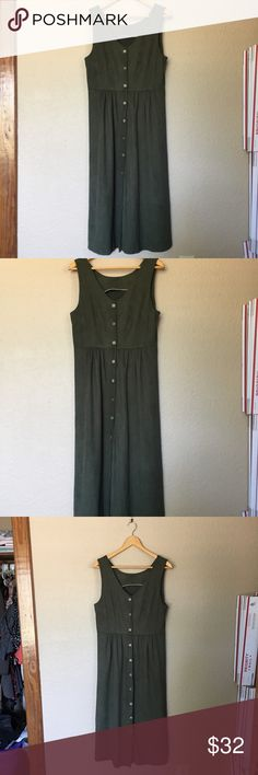 Green Long Fall Midi  Button Down Dress This vintage piece is, I believe, handmade. It's in excellent condition with a suede type feel. Buttons in tact. I would label it as a medium. Labeled as a Midi because it doesn't hit the floor. It's right about the ankle. Vintage Dresses Midi