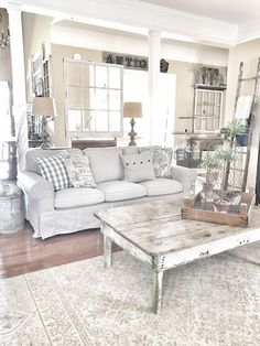 Farmhouse and rustic living room!! IG @bless_this_nest