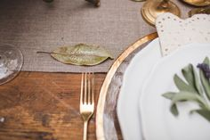 French Farmhouse Inspired Wedding Inspiration in Spokane, Washington Calligraphy on Magnolia leaves by Kathryn Murray Calligraphy