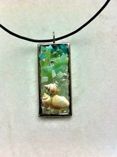 Sea+shell+and+glass+mosaic+pendant+by+Albedomosaics+on+Etsy,+$25.00