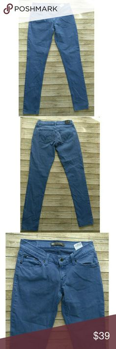 Levi's 524 Superlow Jeans A lovely shade of blue!! Cute Levi's Jeans 524 Super low. Size 5M approx 13-14 inches in waist 30 inch inseam. 99% Cotton, 1% Spandex. Levi's Jeans