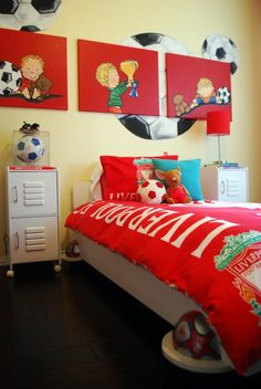 Juls would love for me to design her a room like this! I would put b/w photos of her playing soccer with accents of red instead of the kids paintings above her bed.