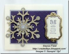 Layered snow flurry flake with itty bitty punched flowers and punched circles... silver and gold and bling!
